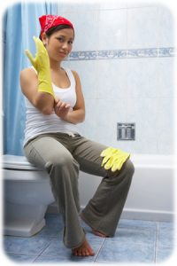 woman-cleaning-shower_esllep